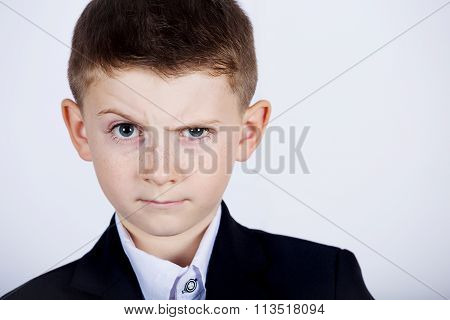 Funny emotion of little boy young man with a raised eyebrow wearing costume with braces.