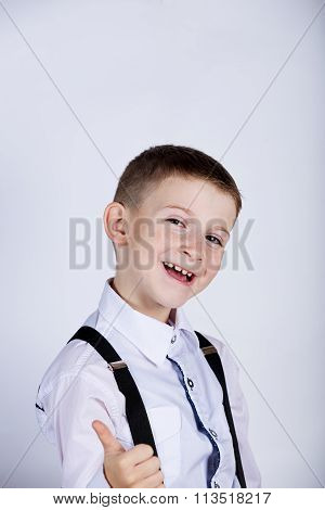 Little boy with thumb up gesture isolated over white background.Portrait of confident happy little b