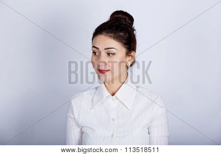 Happy woman excited looking to right. Young woman smiling very happy surprised looking to right.