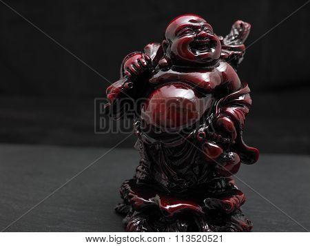 Laughing red buddha