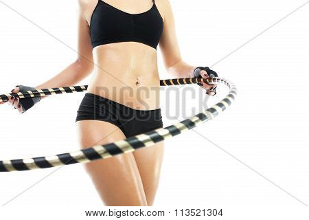 The woman is training your abdominal muscles by turning the wheel hula hoops.