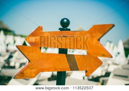 Empty wooden direction sign