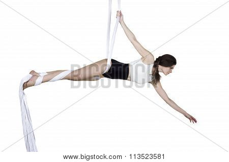 Athletic Woman Doing Some Tricks On Silks