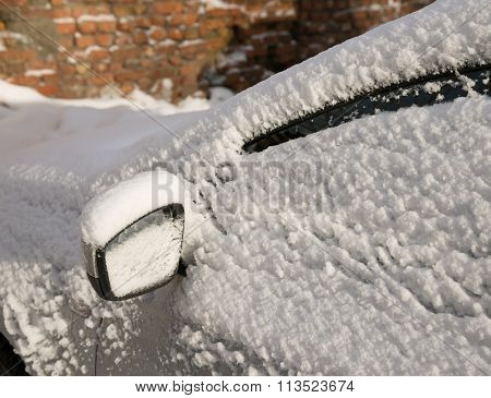 left Wing right car mirror under  snow