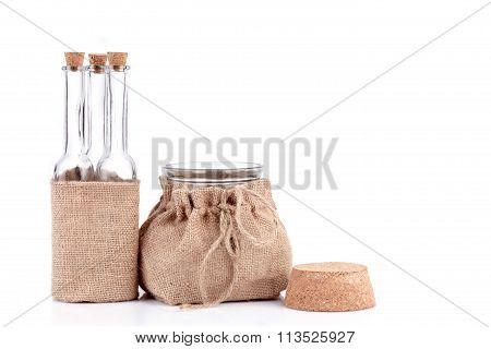 Empty Bottles And Jar In Rustic Hemp Bags