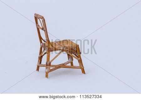 Wicker chair for kids in the snow