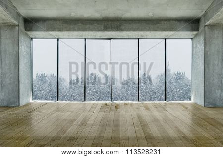 Modern lofty interior with large windows with snow and tree view