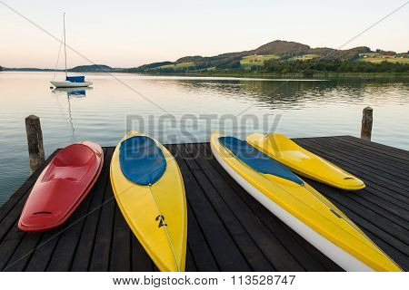 Canoes on harbor deck in Lake Obertumer in Austria