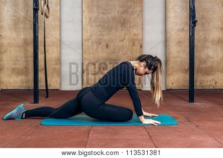 Woman stretching legs in sports club