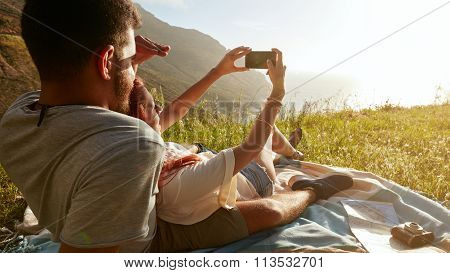Young Couple On Picnic Taking A Selfie
