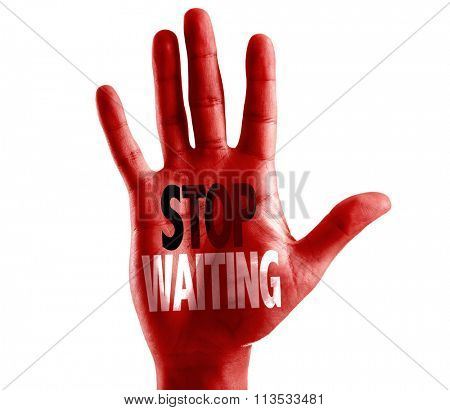 Stop Waiting written on hand isolated on white background