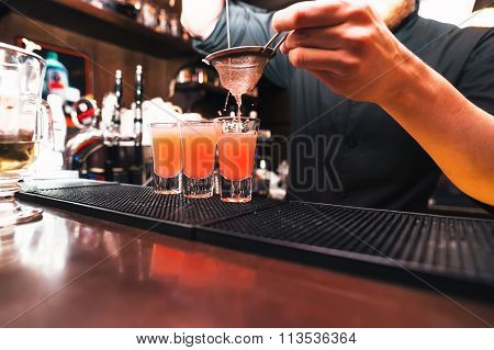 Barman stir alcohol. Process of preparing a cocktail