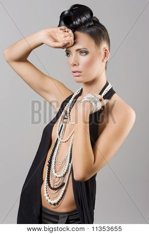 Sensual Girl With Necklace And Hair Style