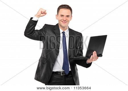 Young Happy Businessman Holding A Laptop
