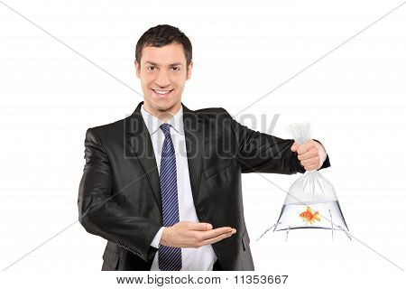 Smiling Man Holding A Plastic Bag With Fish