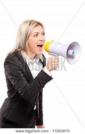 Frustrated Businesswoman Yelling Through A Megaphone