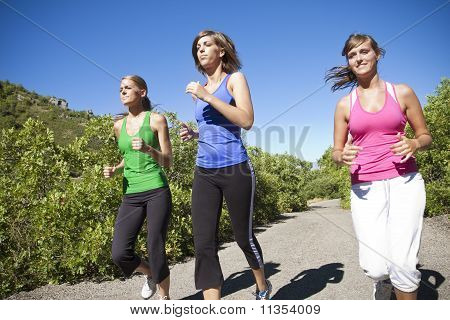 Female Joggers running together outdoors