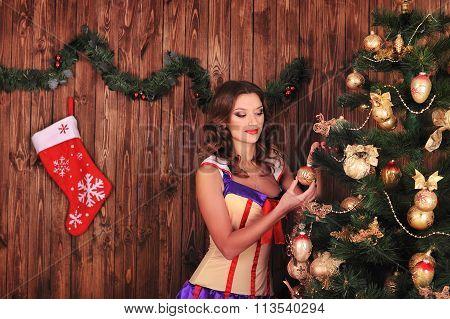 Beautiful Woman Near The Christmas Tree