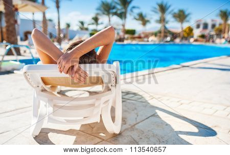 Young Woman Relaxing Near Pool