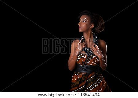 Young Beautiful African Woman Wearing  Traditional Clothes And Jewelry, Isolated Over Black Backgrou