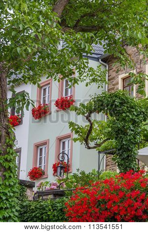 Traditional House With Flower Pots On Its Windows In Beilstein Village On The River Mosel In Germany