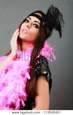 Girl With Pink Feather Boa And Black Feather On Head. Carnival.