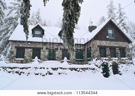 January 7, 2015 in Mt Baldy, CA:  Historic Harwood Lodge built in 1930 which is owned by the Sierra Club and where members can stay overnight surrounded by a pine forest blanketed in snow during a blizzard in Mt Baldy, CA