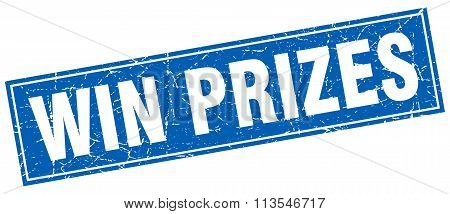 win prizes blue square grunge stamp on white