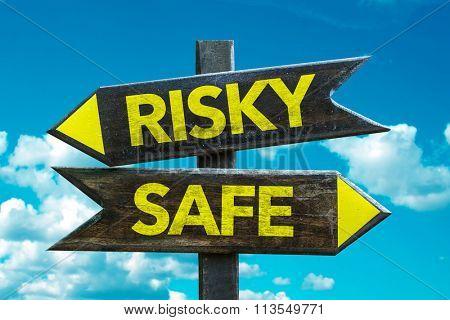 Risky - Safe signpost with sky background