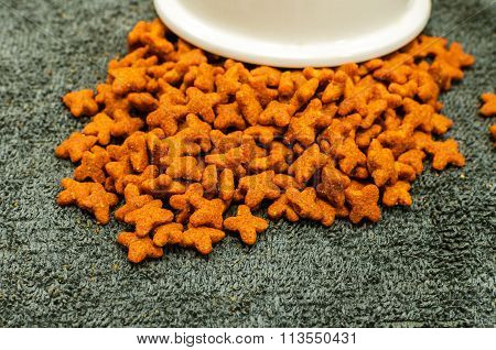 Cat Food, granules, on Grey background