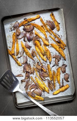 Sweet potato fries and red onion, oven baked.