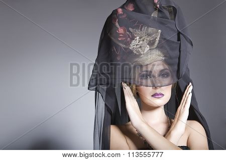 Beautiful Model With A Long Black Veil