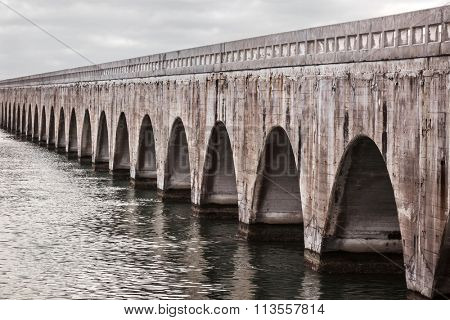 Arches of Old East Coast Railway stone bridge connecting Florida Keys, United States.