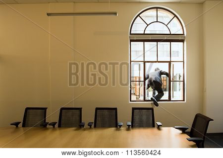Man Escaping The Office Boardroom