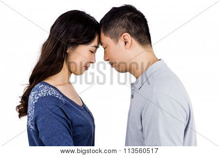 Loving couple head to head against white background