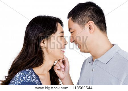 Loving man adoring happy woman against white background