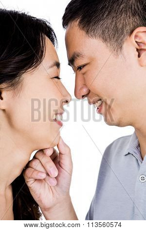 Cheerful man adoring woman against white background