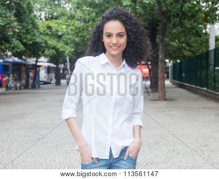 Young Caribbean Woman With Curly Hair Walking In A Park