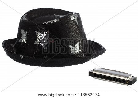 New Classical Harmonica Of Metal And Party Hat On A White Background