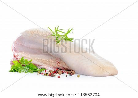 Raw Cow Tongue With Greenery And Dry Peppers Is Isolated On White Background