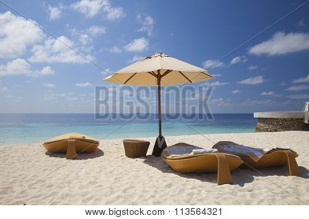 Loungers On The Beach In The Maldives