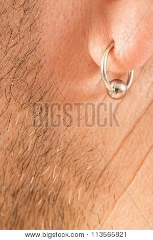 pierced ear of a  man