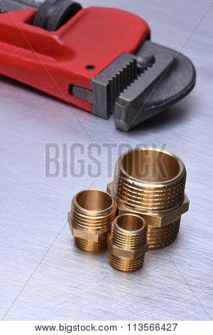 Equipment Plumbing & Heating Contractors, brass plumbing parts with wrench