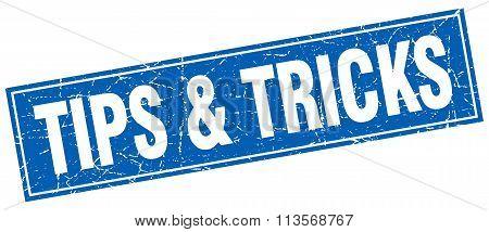 Tips & Tricks Blue Square Grunge Stamp On White