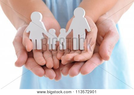 Concept of united family - figures of parents and kids in girls and mothers hands