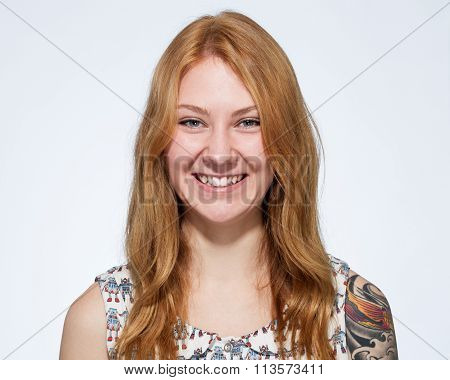 Portrait Of A Smiling Young Ginger Woman  With Natural Make Up