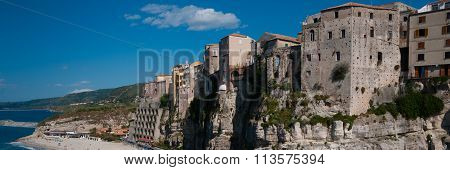 Italian houses fronting the sea on cliff over coast of Tropea