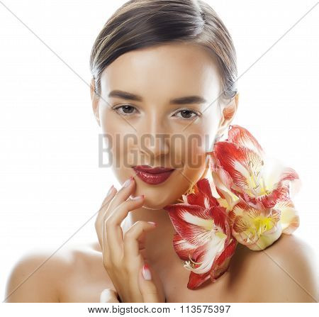 young pretty brunette woman with red flower amaryllis close up isolated on white background. Fancy f