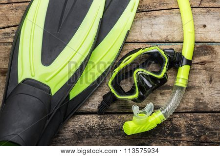 Snorkelling Equipment On Wood Background