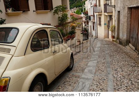 Small italian car on narrow road in village Scilla